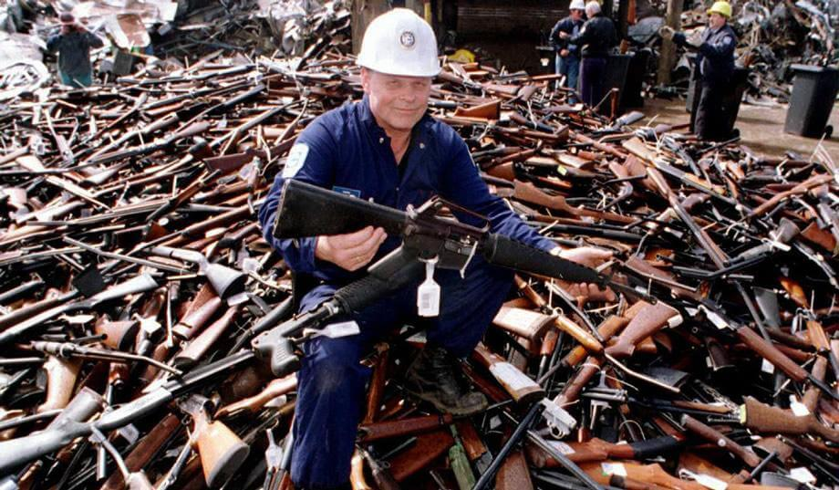 An Australian government worker displays a rifle from the 1996 government buy-back program in this 1996 photograph by William West/AFP/Getty.
