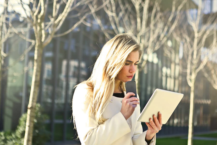 Blonde girl using mobile devices.