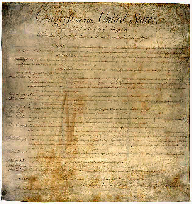 The original Bill of Rights document is now yellowed by age.