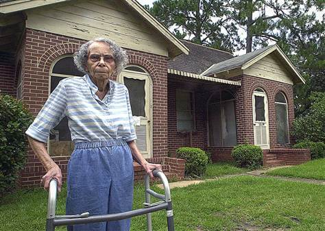 Julia Lemon stands outside home she defended from eminent domain laws.