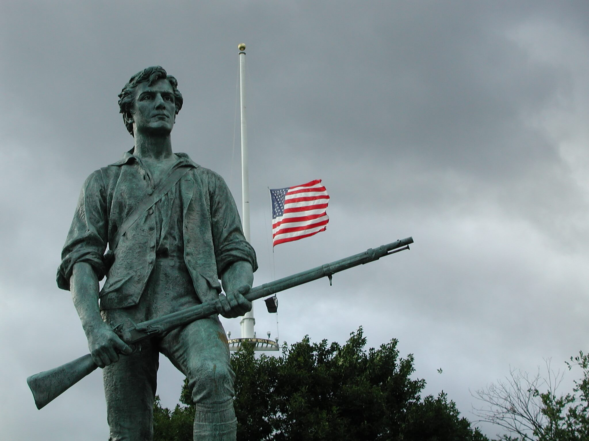 Minuteman sculpture by Henry Hudson Kitson stands in Minute Man National Historical Park in Massachusetts.