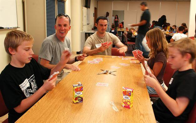 More than just a game - Family enjoys a card game together | Department of Defense (DOD)