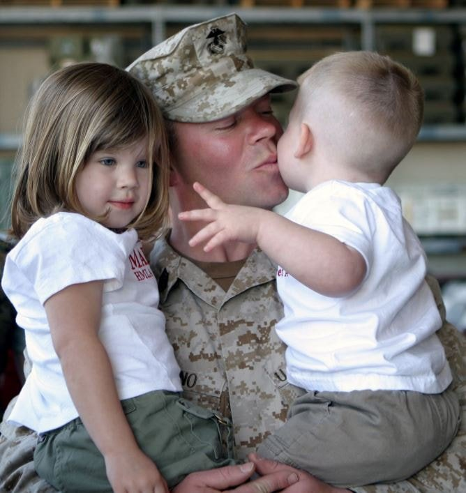 Soldier kissing his family