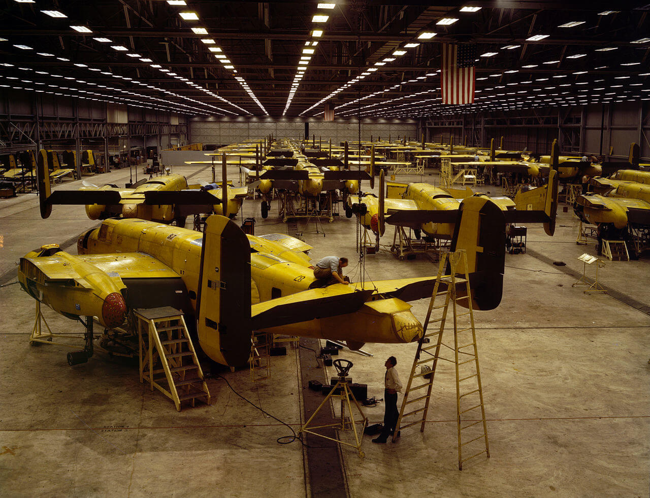 Workers assemble B25 Mitchell airplane (October 1942) - Kansas City, KS