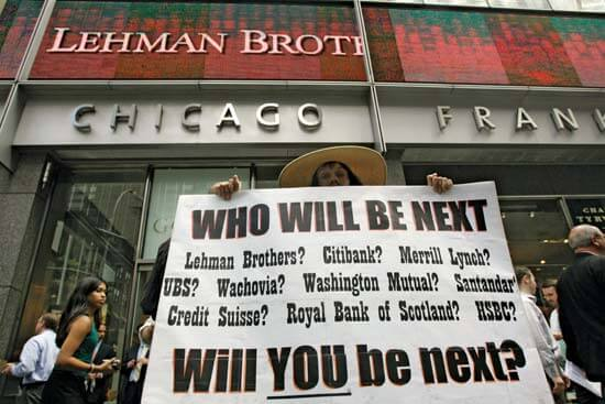 Man holds list of banks responsible for Great Recession - 2008 - Mary Altaffer/AP