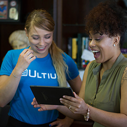 Ultius staff using a tablet